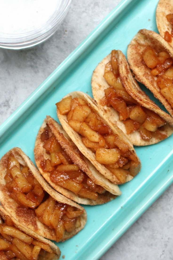Apple Pie Tacos - A healthier alternative to deep-fried versions, coming together in no time. Cinnamon sugary apple filling in crispy & sweet tacos.