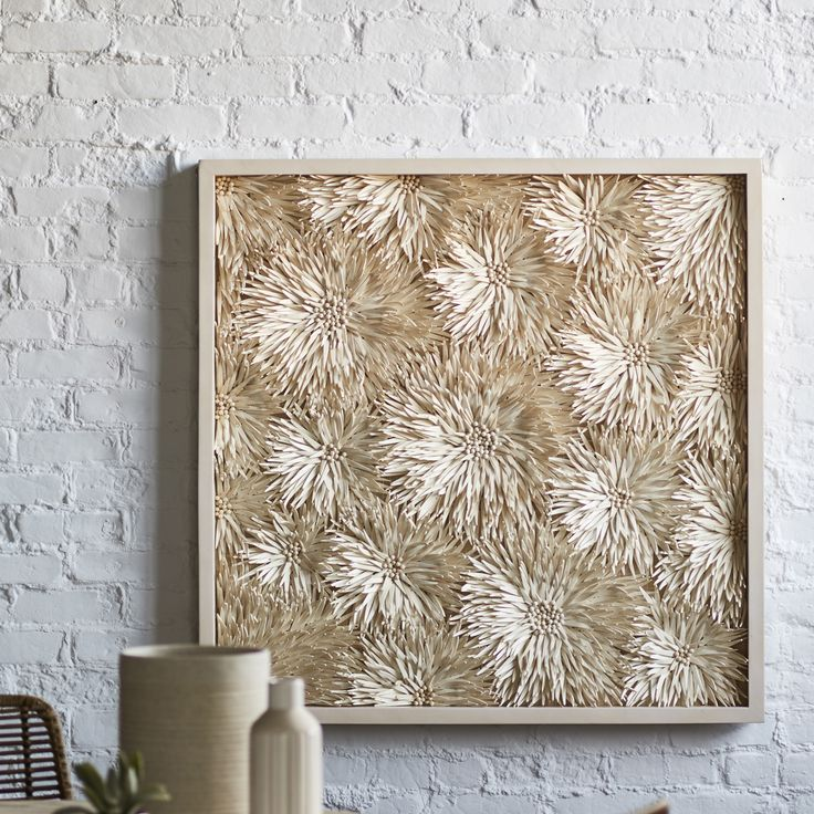 Palecek dandelion coco wall decor hand cut coconut shells arranged in flower shaped formations