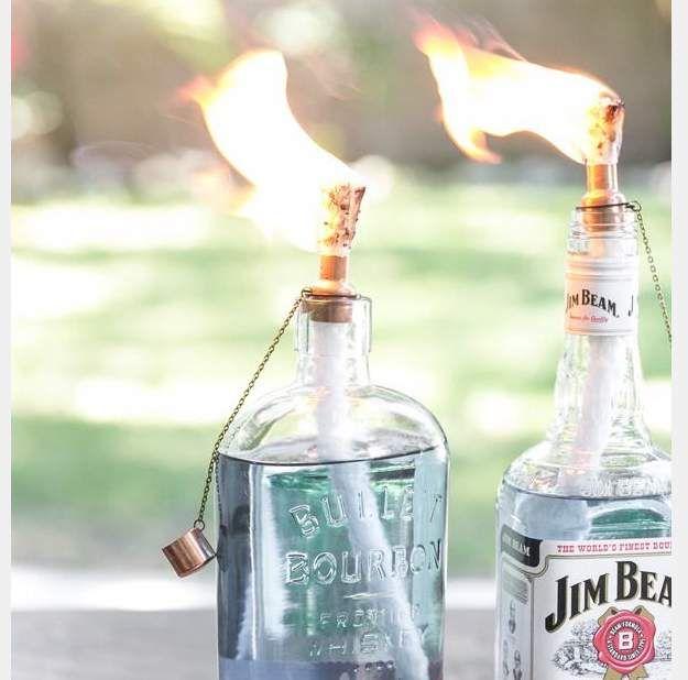Tiki Torches Upcycled Glass Bottles DIY | Best Home Depot Hacks and Homesteading Tips & Tricks at http://pioneersettler.com/home-depot-hacks-homesteading-tips-tricks