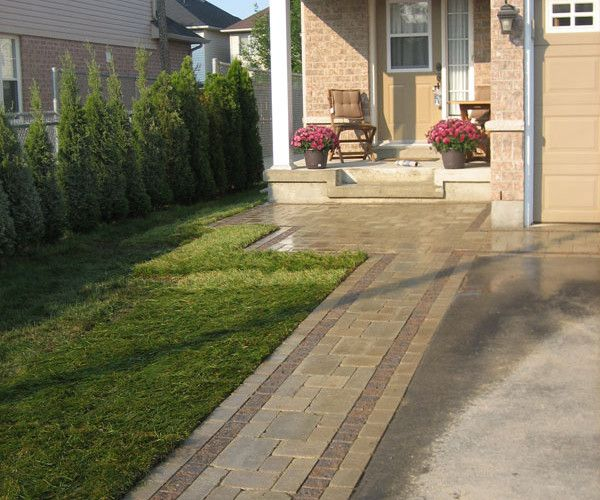 What First Impression Does Your Front Door And Walkway: Interlock Driveway Against Asphalt