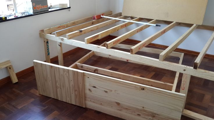 This guy combined two rooms into one by building a roll-away bed under a stage