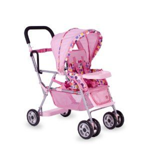 Joovy Toy Doll Caboose Tandem Stroller - Pink Dot by JOOVY. $79.99. Rear platform and seat to accommodate two dolls or stuffed toys, removable canopy, two position footrest, and storage basket.. Deluxe doll stroller is just like the real thing has doll car seat carrier system and snack tray. Swivel front wheel are easier to steer, more fun and realistic.. Two-Position front seat with fully adjustable 5-point harness, two position footrest and deluxe padded hand...
