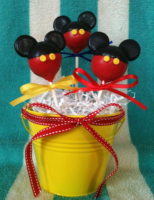 Mickey Mouse Cake Pops ~ Says: They are basic round pops with a half of a mini Oreo for the ears...  Dip first in red, stick in the cookies, allow to dry then dip half in black.