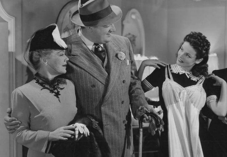 """Spring Byington, Laird Cregar, and Gene Tierney in """"Rings on Her Fingers"""""""