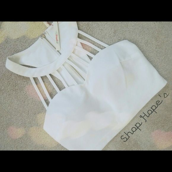 1 HR $25 SALE! ⚪Shop Hope's Boutique Crop Top⚪ New with tags!! (One is ripped off though, other one still attached. Happended just today) ⚪This is white and says so on tag as shown. ⚪Fully zips in back.  Model is wearing the exact item in the last photo shown. $34 trade value! Shop Hope's  Tops Crop Tops