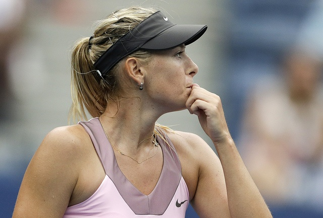 Maria Sharapova, of Russia, pauses during her match with Marion Bartoli, of France, in the quarterfinals during the 2012 US Open tennis tournament, Wednesday, Sept. 5, 2012, in New York. (AP Photo/Darron Cummings)