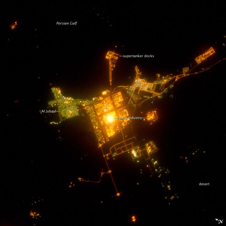 NASA~Al Jubayl, Saudi Arabia at Night~The bright lights of Al Jubayl's industrial center stand out in a nighttime photograph from the International Space Station.Industrial Center, Earth Image, Satellite Image, Bright Lights, Al Jubayl, Aerial Image, Aerial View, Center Stands, Saudi Arabia