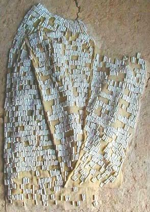 thracianthreads/restoredtunicmade of spondylus beadsfrom the 'Lake Town' settlement near Varna on the Black Sea.