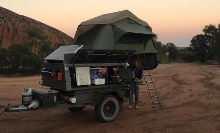 Here is a gullwing way to setup compartment doors on a camp trailer box. The doors act as mini awnings. Photo by Michael Pearson