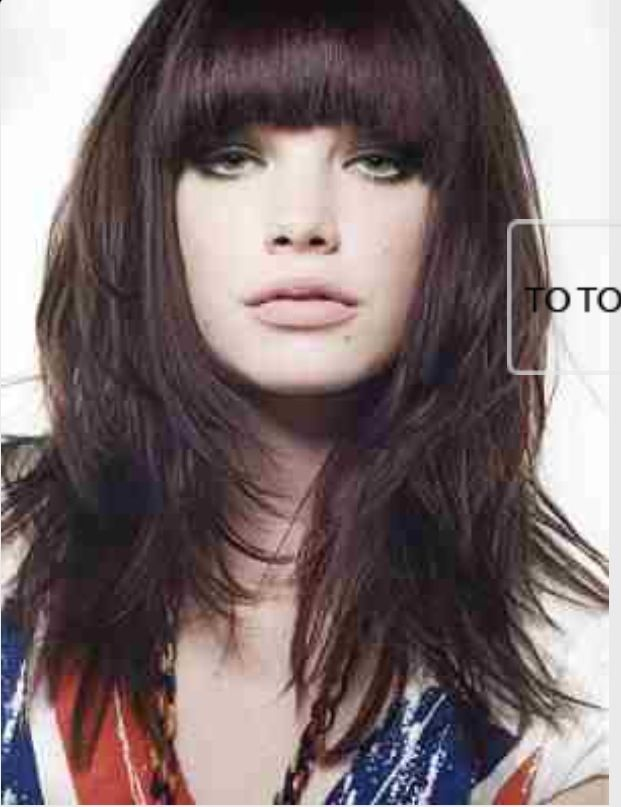 Long, choppy layers with long, thick arched bangs.