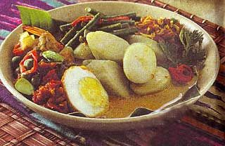 Lontong Medan, sliced rice cakes with variety of topping sauce from Medan (North Sumatra)