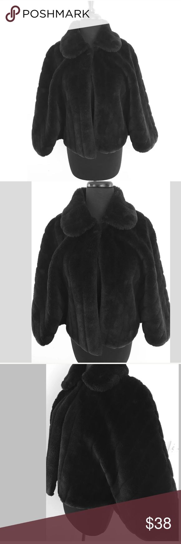 East 5th Black Faux Fur Bolero Cape Jacket East 5th Black Bolero Cape Jacket   Perfect for holiday festivities,any formal event or to wear every day to dress up an outfit   Size Large / X Large - Runs Small - Best fits a Medium 77% Acrylic & 23% Polyester   In overall good condition but does have a very small area in the center back where the fabric looks a little worn when it's rubbed down but not visible when the fabric is rubbed up. Check out the rest of our closet and bundle 2 or more…