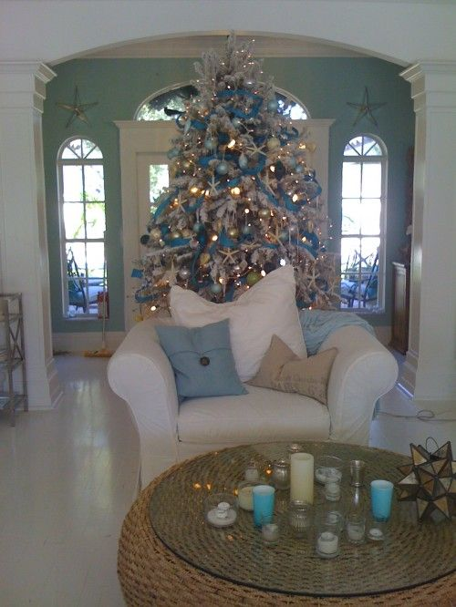beach house Christmas..I prefer the traditional red, green and gold, but this is a beautiful tree and a lovely setting.