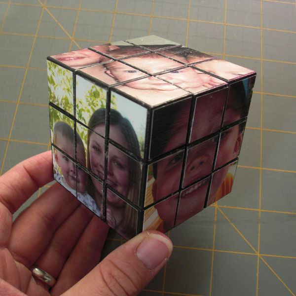 dollar store version of the Rubiks cube with Mod Podged pictures onto it.  Good personalized gift idea.