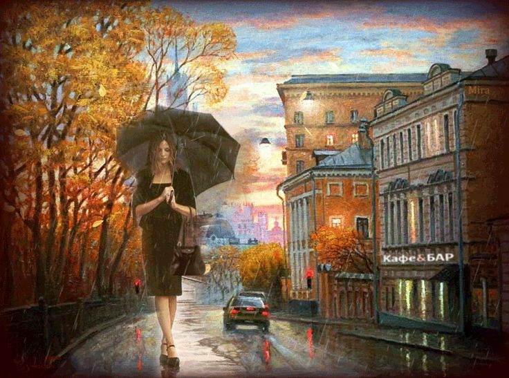 La mujer pasea bajo la lluvia.