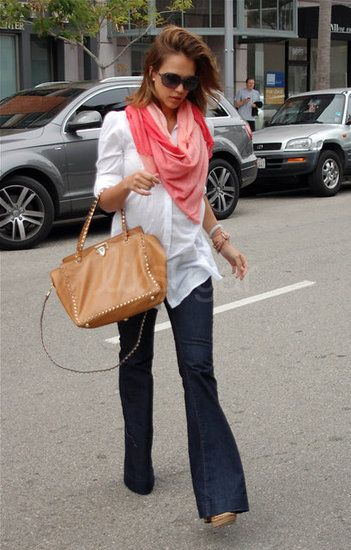 Jessica Alba: Exiting a mani-pedi, Jessica was seen wearing dark flared jeans and a puff-sleeved button-down, with a bright pink scarf to perk up the style.
