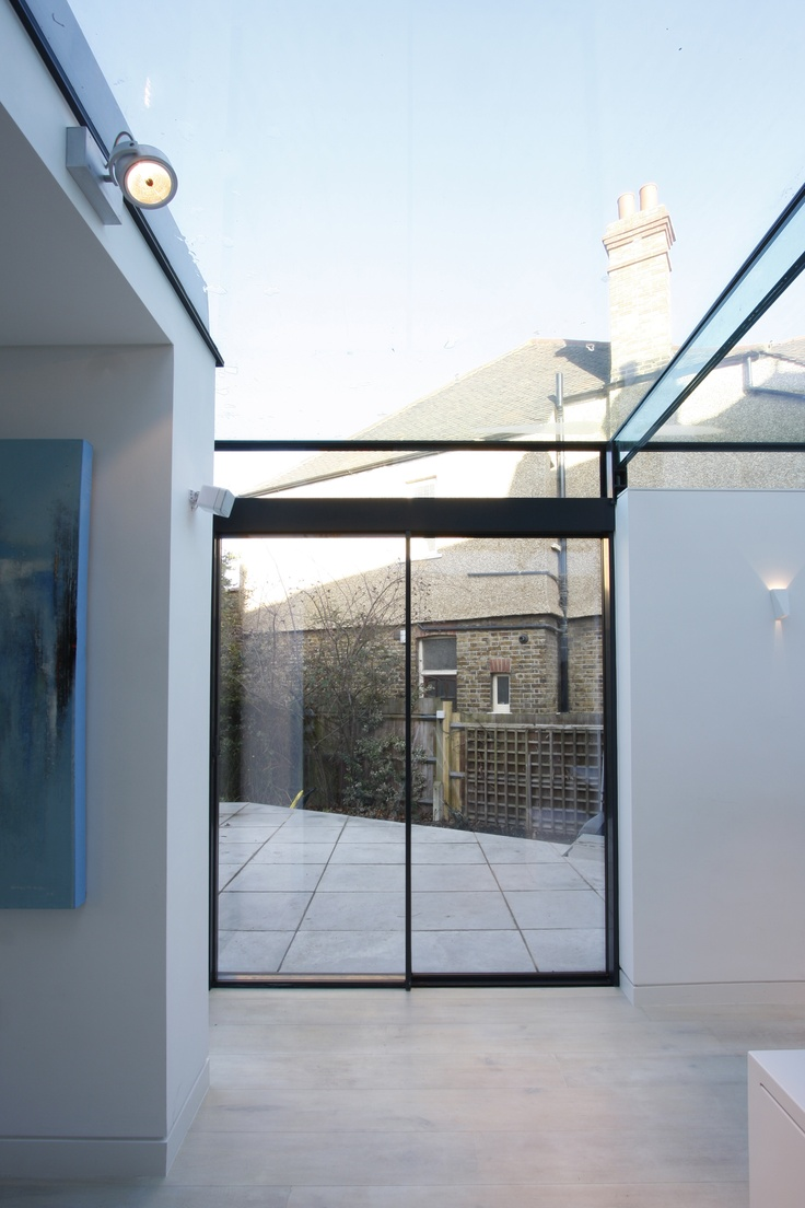 One fixed one sliding minimal window meeting a structural for Glass roof design