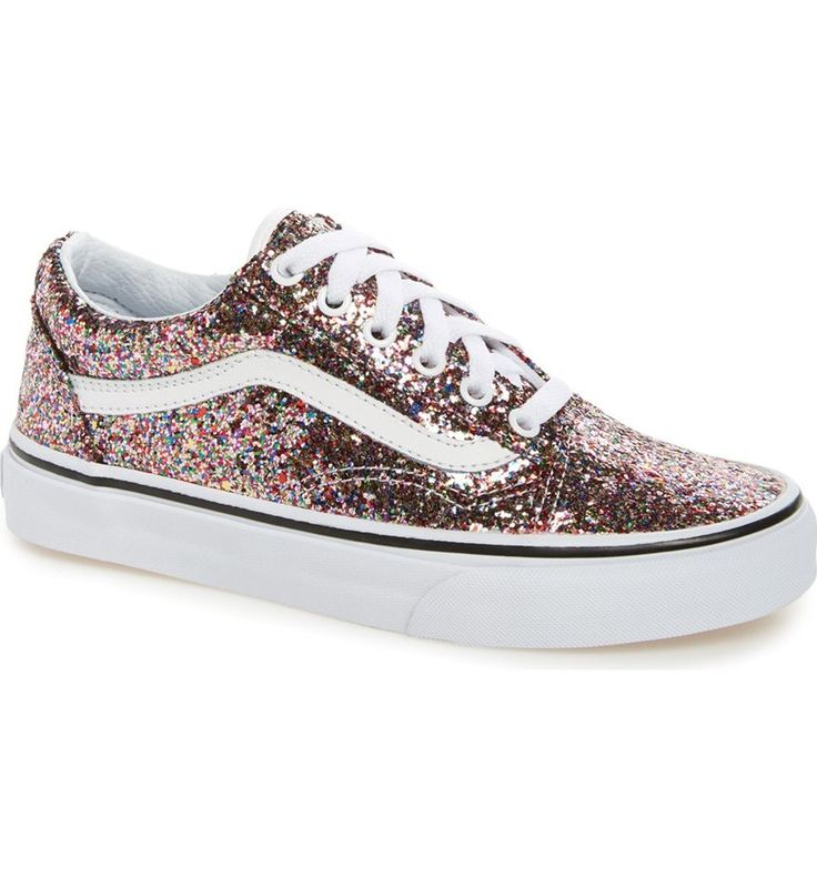 A glittery finish adds pizzazz to these classic-cool sneakers featuring vintage skate style and a signature leather stripe.