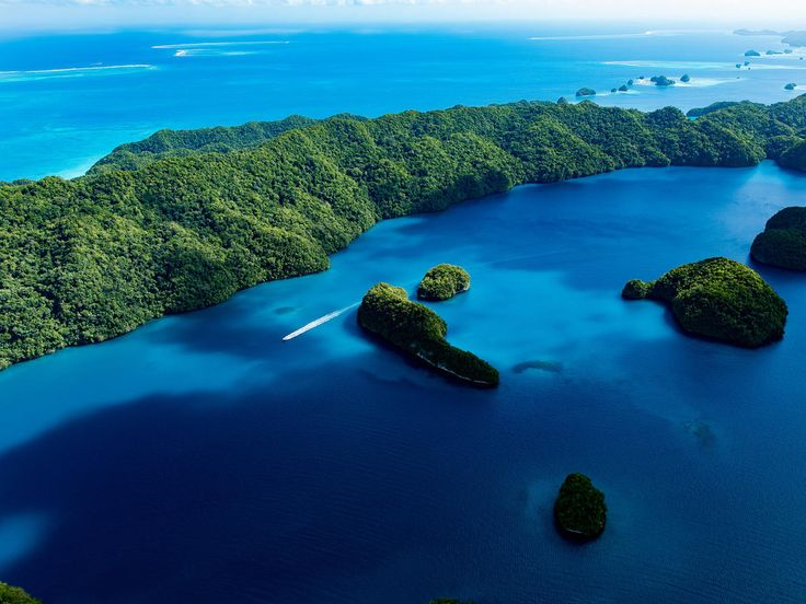 Federated States of Micronesia sky water geographical feature landform Sea Nature archipelago ecosystem Ocean reef green Coast Island islet coral reef bay Lagoon underwater tropics plant