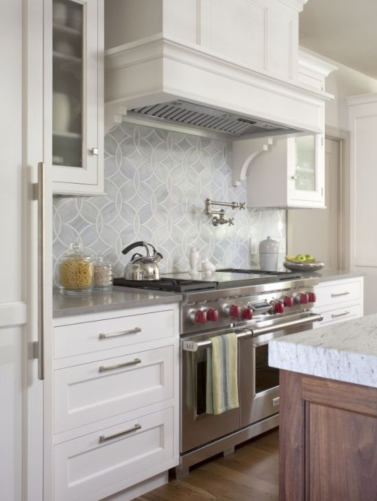 Gray tile white cabinets wood islands with white marble for Ceramic tile under kitchen cabinets