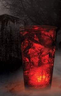 The Wicked Spirit (amc theaters)  Angry Orchard Hard Cider with a kick of Fireball Cinnamon Whiskey with a glowing cube.