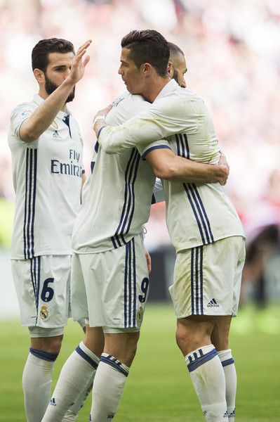 Cristiano Ronaldo Photos Photos - Karim Benzema of Real Madrid celebrates with his teammate Cristiano Ronaldo of Real Madrid after scoring the opening goal during the La Liga match between Athletic Club Bilbao and Real Madrid at San Mames Stadium on March 18, 2017 in Bilbao, Spain. - Athletic Club v Real Madrid CF - La Liga
