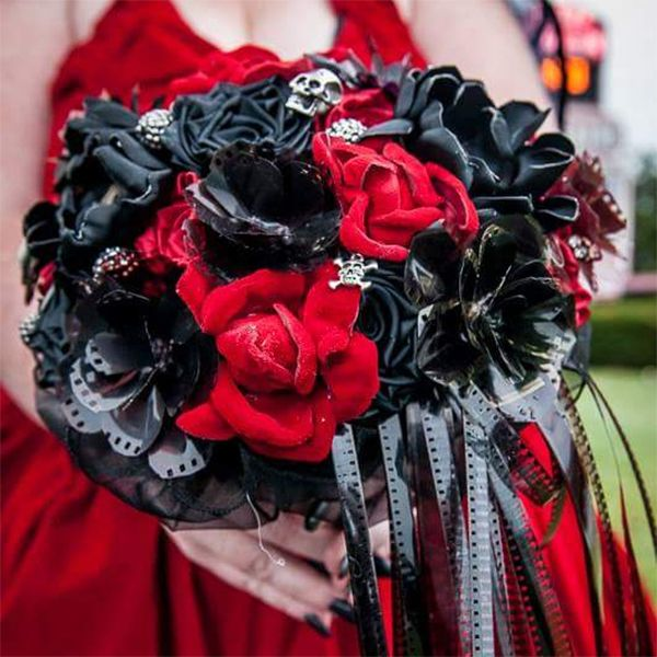 For her horror movie-themed wedding, Philadelphia bride Amanda worked with designer Anna Coy of Hold and Have to create this one of a kind boo-quet. It contains red leather roses, strands of actual film reel, and miniature skulls.