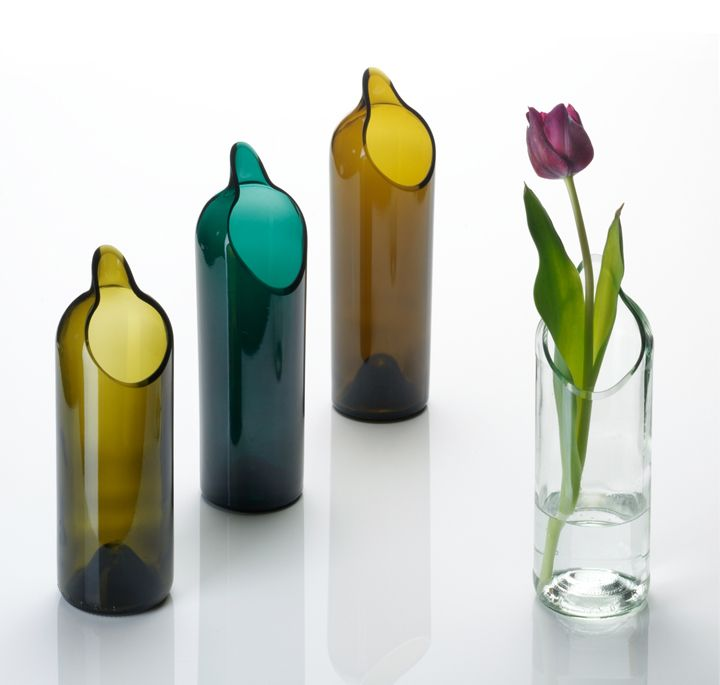 <3 Vases made out of Bottles. Would be great to paint it with elmers glue and food coloring. Love the sea glass look!