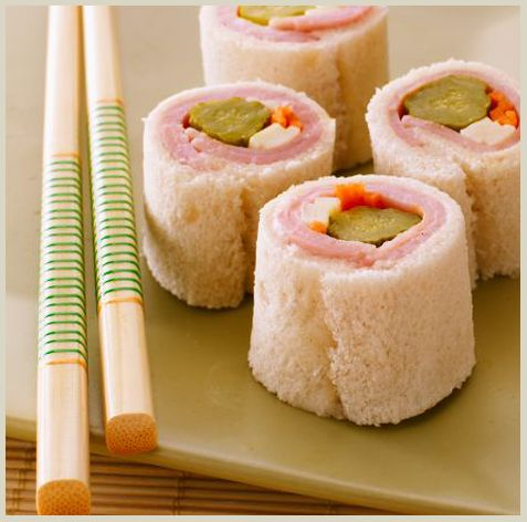 sushi for kids ... cut crust off bread, slightly flatten bread with rolling pin, spread 1 tsp creamy salad dressing on bread, add 2 slices ham, 2 strips of cheese, a few carrot sticks and a sweet pickle. Roll up and cut into 3 pieces. So cute for lunch or after school snack. Add the PB & J Sushi and the Rice Krispies Sushi and you have a party!