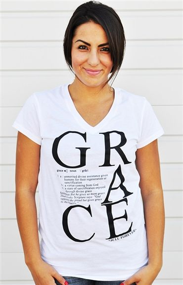 Grace defined is the word itself spelled out with giant letters and placed in a stacked formation. On the shirt you'll also see the actual dictionary definition of the word Grace and the scripture James 4:6 as the sentence example.