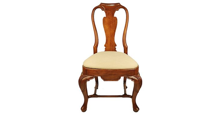 This English-country Queen Anne-inspired side chair has a stretcher base, an antiqued mahogany finish and crème striae fabric upholstery on the seat.