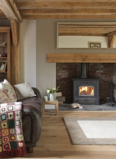 Say yes to a wood burner! #FADSWinterWarmer #winter Exposed oak beams, oak wood flooring, Wood burning stove, Oak Mantel,