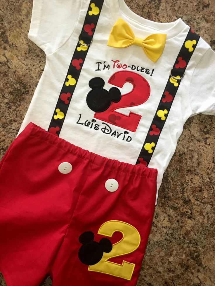 This set would be great for a birthday party, pictures, or as everyday wear for a special little one.  ***************************************** READ INFO BEFORE PLACING ORDER *****************************************  **Set can be made in ANY of my Mickey Birthday Themes!** *SHIRT: The shirt number will be made using licensed Mickey Mouse fabric. A name can be added to the shirt at no additional charge. The suspenders are made from Ribbon that is sewn onto the shirt. The bow tie is on a…