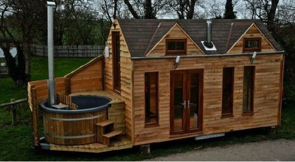 Tinywood Home on Trailer with Outdoor Hot Tub Built In
