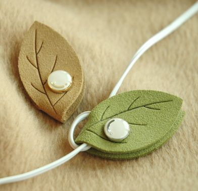 Cute leaf earphone organizer, god knows I spend 20 min untangling!