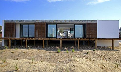 Casa Do Pego, in Comporta, Portugal, is modern and stands out architecturally, and also has a an internal courtyard and heated pool on the r...