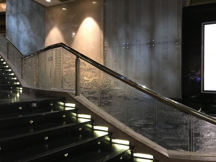Photo 10: Glass staircase balustrade at Crown. The quality that is most intriguing and beautiful about this, is the thick almost water like surface texture, uneven yet smooth. It is so unusual to see glass so rough and imperfect that you can't help but want to touch it.