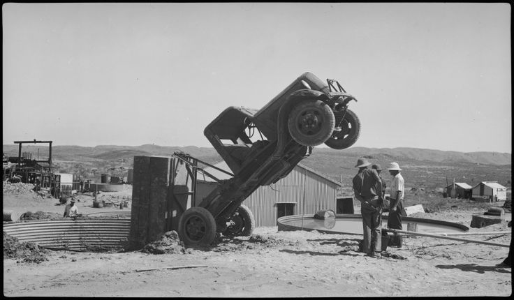 112734PD: Men attempting to free a truck upended in a water tank at the Old Ironclad Battery, Marble Bar, Western Australia, ca. 1940.  http://encore.slwa.wa.gov.au/iii/encore/record/C__Rb4393881__Sgold%20water__Ff%3Afacetmediatype%3Av%3Av%3APhotograph%3A%3A__P0%2C6__Orightresult__U__X2?lang=eng&suite=def