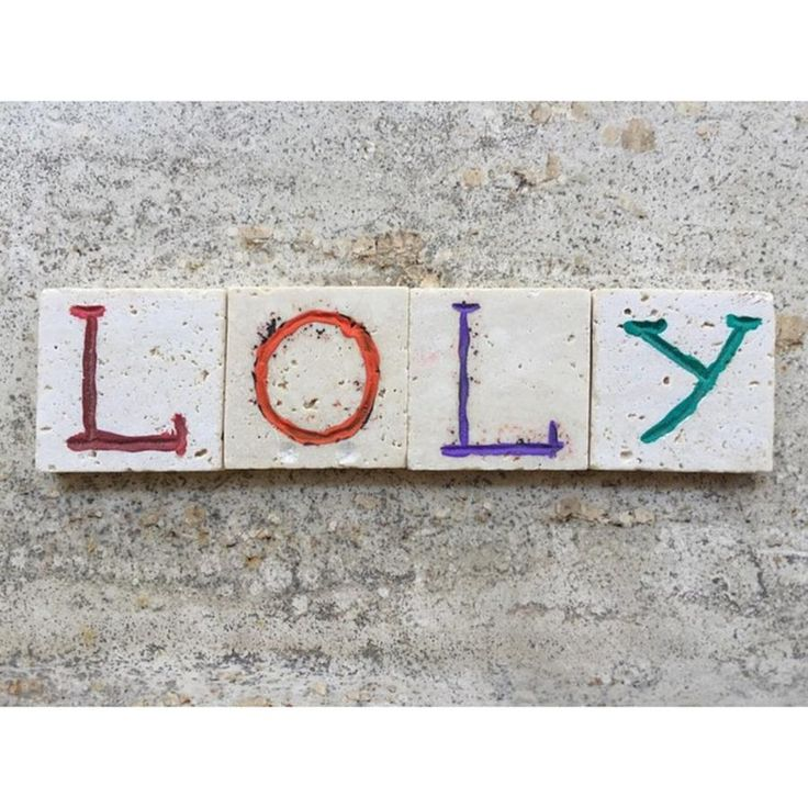 Loly, Name On Carved Travertine Pieces Photograph