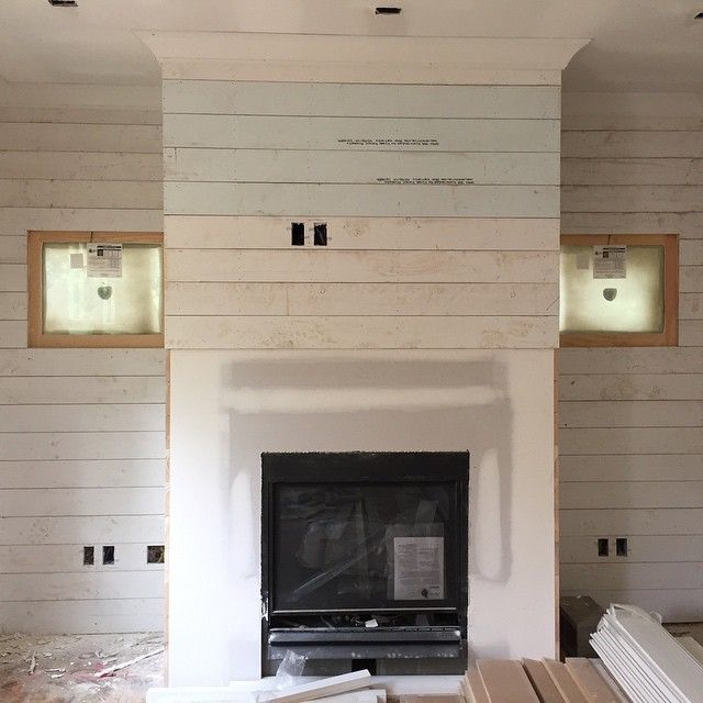 OBSESSING over our shiplap wall around the fireplace. Can't wait to see it painted and with our built-ins on both sides!! Probably my favorite part of our house so far! #livingstonremodel #shiplap #homeremodel #renovations #fixerupper