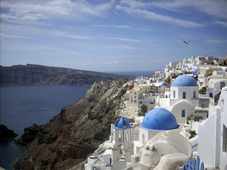 Santorini - black rock and blue water    Michael Virtanen/The Associated Press