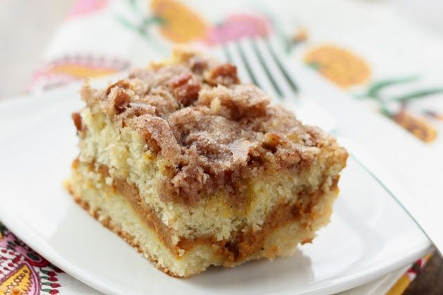 Pumpkin Coffee Cake. Rich coffeecake filled with a creamy pumpkin filling and then topped with a crunchy cinnamon sugar pecan topping.