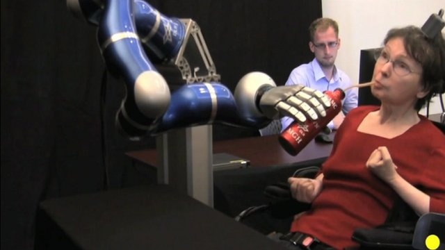 BBC News - Paralysed patients use thoughts to control robotic arm