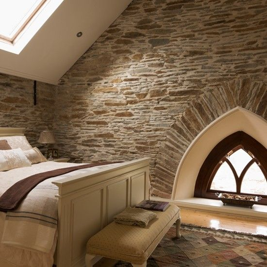 Country bedroom with exposed brick walls