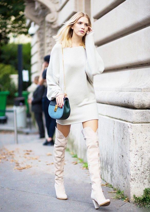 Elena Perminova wears a white mini sweater dress, a Chloé Drew bag, and thigh-high suede boots