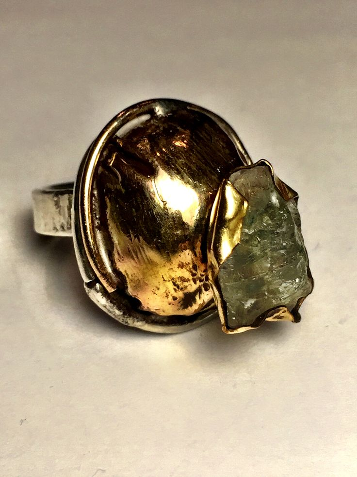 Raw emerald in gold filled setting with sterling silver band