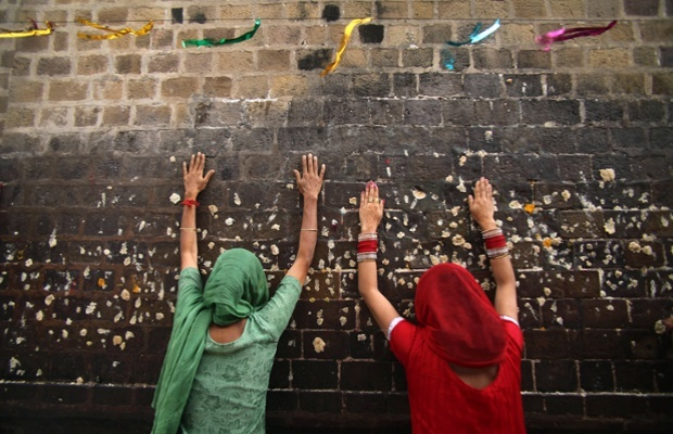 Hindu devotees offer prayers at the Kali Temple during the Navratri festival in Jammu, India. Navratri, or the festival of nine nights, is dedicated to the worship of various goddesses
