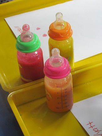 Baby bottle painting. Bottle aren't squeezable so children have to use their fine motor skills to get the paint onto the paper.