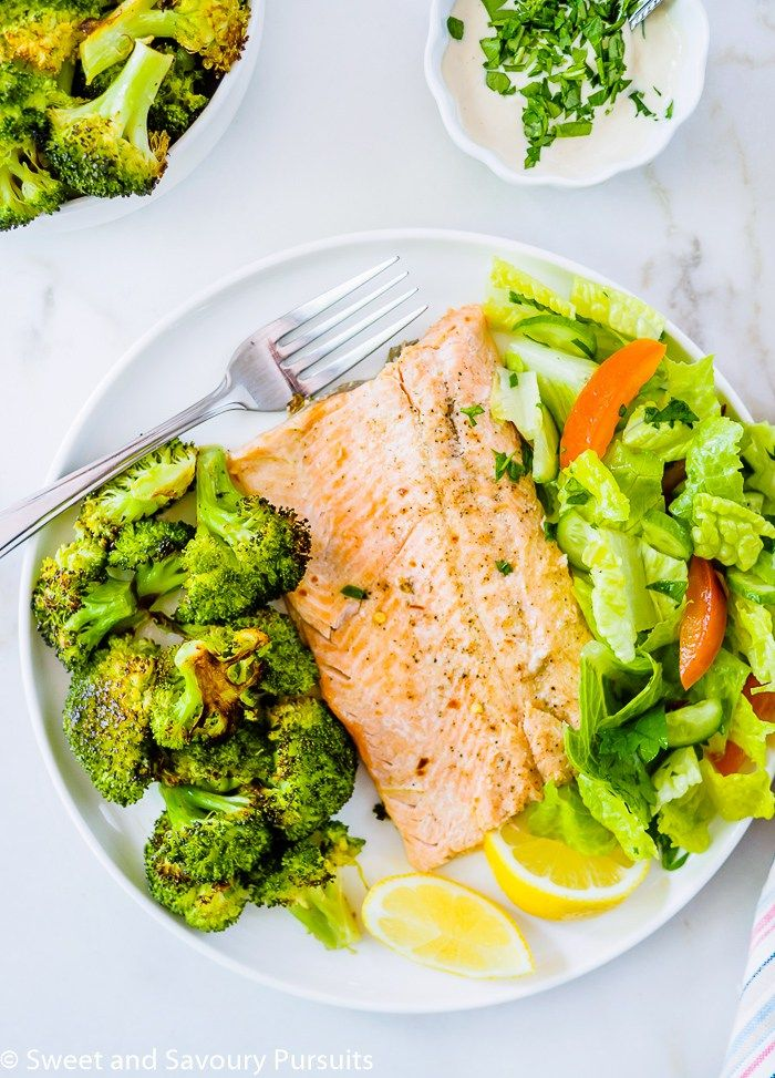 Make this simple one-pan recipe for Baked Rainbow Trout Fillets with Roasted Broccoli for a healthy, light and delicious meal that can be ready in 30 minutes.