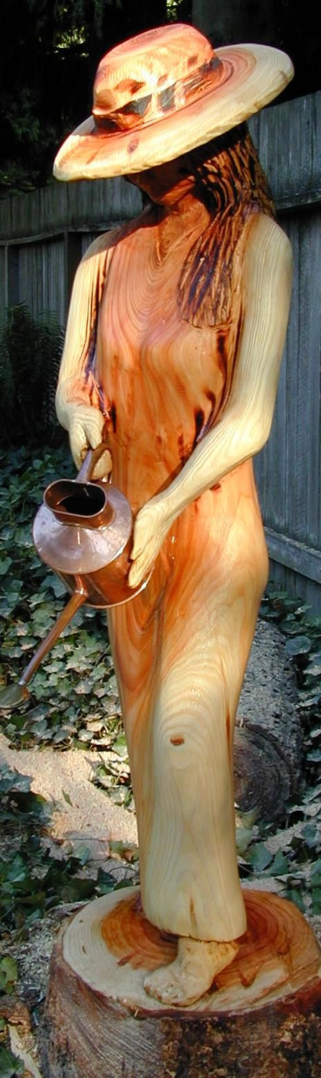 """Lady Watering"" by Chainsaw Sculptures by award winning artist Bob King"